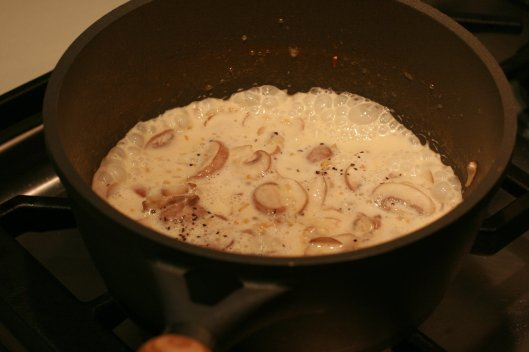 Mushrooms cooking in the butter cream base