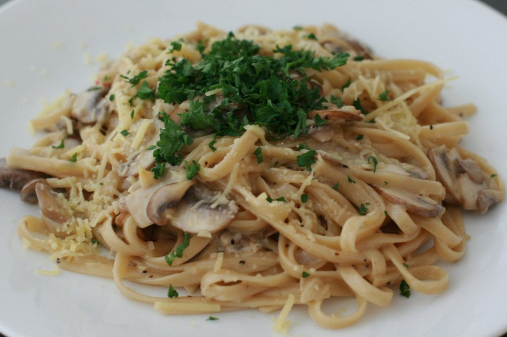 Linguine in mushroom cream base topped with earthy parsley