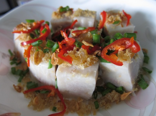 Steamed yam cake topped with red chillies, fried shrimp, spring onions and fried shallots