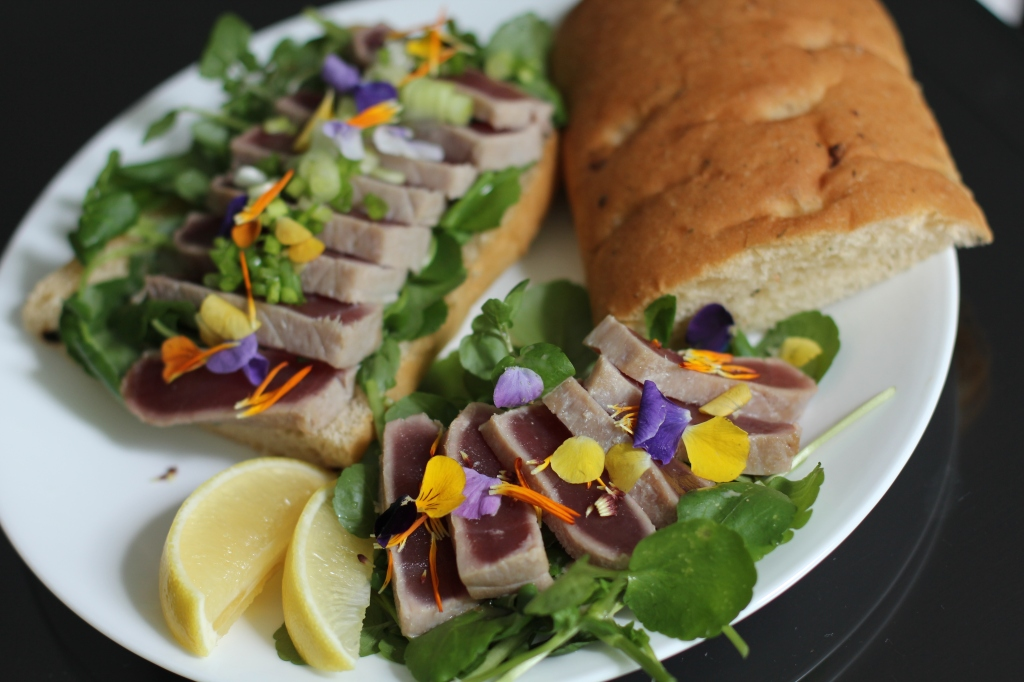A light, refreshing sandwich of seared tuna on a bed of watercress.