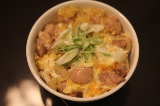 A dish made with chicken, eggs, onions, sake and mirin